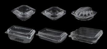 Recipientes plásticos vazios isolados no preto Fotos de Stock Royalty Free