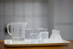 Recipients in chemistry lab. Color image of some plastic recipients in a chemistry lab Royalty Free Stock Photos