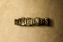 RECIPIENTS - close-up of grungy vintage typeset word on metal backdrop Royalty Free Stock Photos