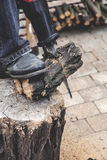 Reciprocating power saw sawing round timber closeup Royalty Free Stock Photo