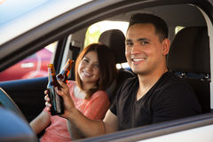 Reckless adults drinking and driving Stock Images