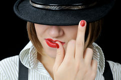 Reckless cool girl in black hat Stock Images