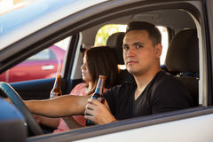 Reckless driver drinking beer Stock Photo
