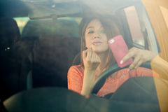 Reckless girl behind the wheel Royalty Free Stock Photography