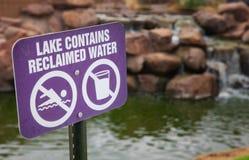 Reclaimed Water Sign. A reclaimed water sign in front of a small lake royalty free stock photos