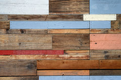 Reclaimed wood panel. A wall made of various pieces of reclaimed and recycled wood royalty free stock image
