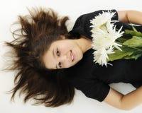 Reclinación con las flores Imagen de archivo libre de regalías