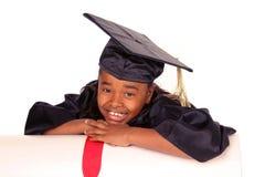 Reclinación sobre su diploma Imagen de archivo libre de regalías