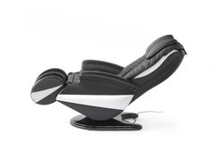 Reclined massage chair. Black leather modern massage chair in reclined position, isolated on white royalty free stock photo