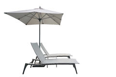 Recliner beach bed with parasol isolated Royalty Free Stock Photos