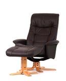 Recliner preto com footstool Foto de Stock