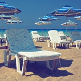 Recliners on beach Stock Photography