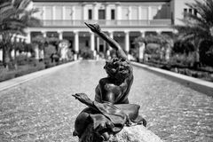 Reclining Bacchus. Los Angeles, USA - October 4, 2009: Bacchus statue at the Getty Villa in Los Angeles. The Getty Villa is a roman villa recreated after ancient Royalty Free Stock Photo