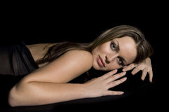 Reclining Beauty on Black stock photos