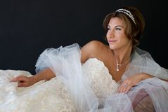 Reclining Bride with Happy Look on Face Royalty Free Stock Image