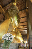 Reclining Buda. At the temple in Bangkok, Thailand stock images
