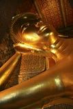 Reclining Buddha. Statue of Reclining Buddha at Wat Pho temple, Bangkok, Thailand Stock Photo
