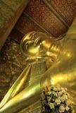 Reclining buddha. The large golden Reclining Buddha at Wat Pho, Bangkok, Thailand Royalty Free Stock Photography