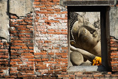 Reclining buddha. In window frame Royalty Free Stock Photography