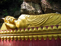 Reclining Buddha. Giant statue of a reclining Buddha, in Luang Prabang, Laos royalty free stock photography