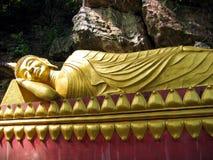 Reclining Buddha. Giant statue of a reclining Buddha, in Luang Prabang, Laos Royalty Free Stock Photography