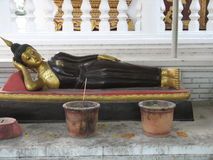 Reclining Buddha. The statue of a reclining Buddha in Chiang Mai, Thailand Royalty Free Stock Images
