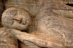 Reclining Buddha. The statue of reclining (recumbent) Buddha is located at Gal Vihara, Polonnaruwa, Sri Lanka Stock Photo