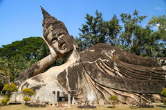 Reclining Buddha. Statue of Reclining Buddha in the Park near Vientiane royalty free stock photography