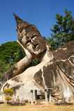 Reclining Buddha. Statue of Reclining Buddha in the Park near Vientiane royalty free stock image