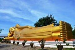 Reclining Buddha of Aranyikawas Temple at Ratchaburi. Ratchaburi (often shortened Rat'buri, Thai: ราชบุรี (Pronunciation)) is one of the central Stock Image