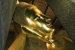 Reclining Buddha of Bangkok. The golden reclining Buddha in Wat Pho temple of Bangkok, Thailand Stock Photo