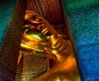 Reclining Buddha, Bangkok, Thailand. Large reclining gold Buddha in Bangkok, Thailand Royalty Free Stock Photo