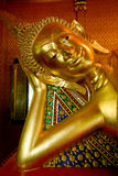 Reclining buddha in a buddhist temple. Royalty Free Stock Image