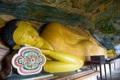Reclining buddha in Cave temple in Milkirigala Royalty Free Stock Images