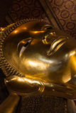 Reclining Buddha face Stock Photos