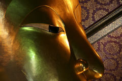 Reclining buddha face Wat Po bangkok  thailand Stock Photography