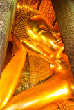 Reclining Buddha figure in Wat Pho Buddhist temple complex in Bangkok, Thailand. Stock Photography