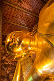 Reclining Buddha figure in Wat Pho Buddhist temple complex in Bangkok, Thailand. Stock Image