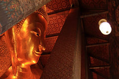 Reclining Buddha gold statue stock image
