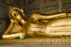 Reclining Buddha gold statue in church Stock Image