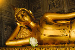 Reclining Buddha gold statue in church. Public place Reclining Buddha gold statue in church Wat Suthattepwararam temple Bangkok, thailand Royalty Free Stock Images
