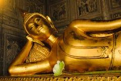 Reclining Buddha gold statue in church Stock Image