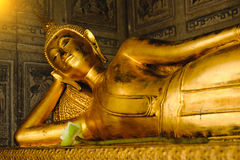 Reclining Buddha gold statue in church Royalty Free Stock Images
