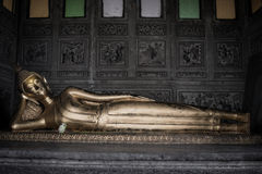 Reclining Buddha gold statue in church Royalty Free Stock Photos