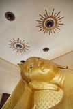 Reclining Buddha gold statue face. Bangkok, Thailand.  Royalty Free Stock Photography