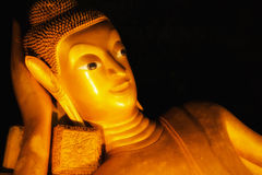 Reclining Buddha gold statue face in Thailand Royalty Free Stock Photo