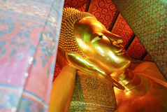 Reclining Buddha gold statue face. Wat Pho, Bangkok, Thailand Stock Photo