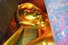 Reclining Buddha gold statue face. Wat Pho, Bangkok, Thailand Royalty Free Stock Image