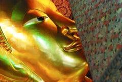 Reclining Buddha gold statue face. Wat Pho, Bangkok, Thailand Royalty Free Stock Photography