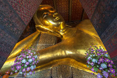 Reclining Buddha gold statue face. Wat Pho Royalty Free Stock Images